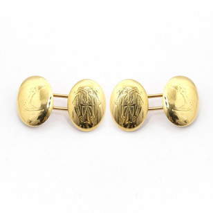 18ct yellow gold, domed oval cufflinks with crest and monogram. £575.00