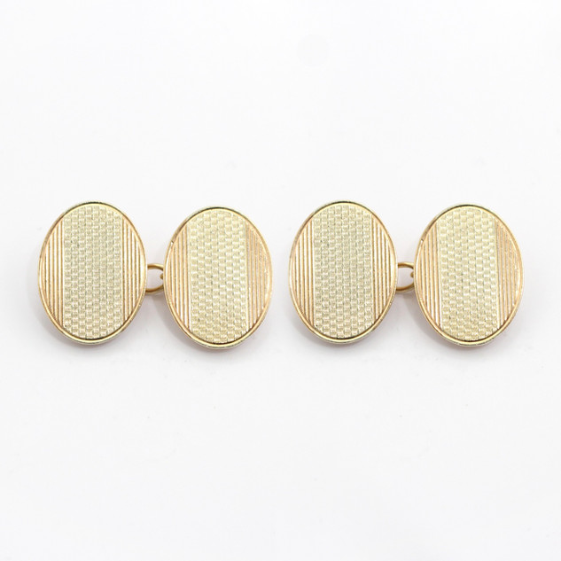 9ct yellow and white gold, engine turned oval chain cufflinks. £385.00