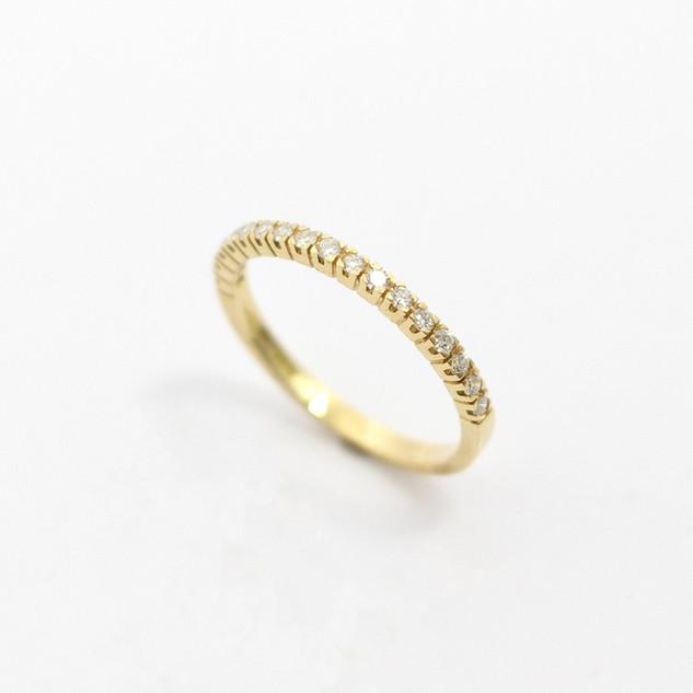 18ct yellow gold fine diamond set half eternity ring. The narrow claw set diamond set ring totalling 0.20ct. £1,100.00