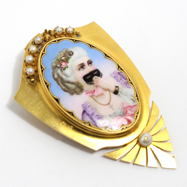 Mid Victorian 15ct yellow gold mounted brooch, with central miniature, the miniature unique set with rose cut diamonds forming a tiara with seed pearl decoration above and below. Locket compartment in reverse. Possibly Italian. £2,250.00