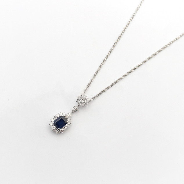 18ct white gold sapphire and diamond cluster pendant. The rectangular sapphire 2.11cts with a border of modern brilliant cut and marquise cut diamonds totalling 1.98cts, G colour, Vs clarity. Completed on a heavy spiga chain. £5,750.00