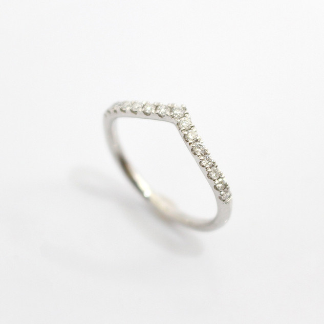 A platinum pointed diamond set eternity ring with a definite point feature. Total weight 0.21ct, in a claw setting. £850.00