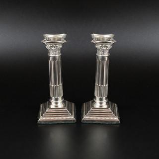 A pair of Corinthian column candlesticks. Sheffield 1976. 5.5 inches  £ 450.00