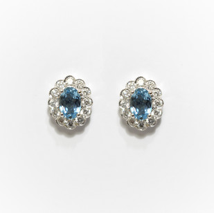 18ct white gold aquamarine and diamond cluster earrings. The aquamarines weighing 0.79ct and total diamond weight 0.52ct. £1,650.00