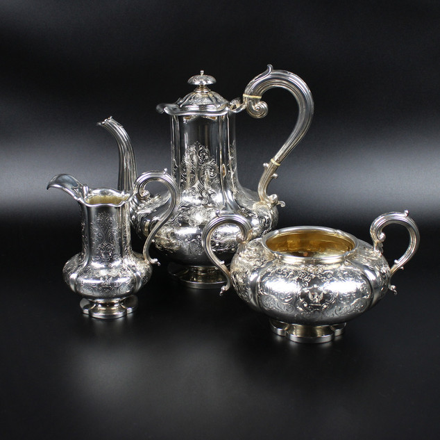 Reily and Storer 1842 - 43 Coffee pot, cream & sugar 3 piece coffee set.  Crested with Phoenix in flames for MacGill.  Engraved on each piece Revd. Thomas MacGill Liverpool 1845.  Lobed bodies set on shaped feet. This was made by the London manufacturing silversmiths Charles Reily and George Storer who were in partnership from 1829. They were well known to have made other silver which directly copied antique pottery.   Sugar – 13 oz Cream – 9 oz  Coffee Pot – 26 oz   £1,850.00