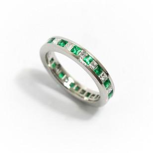 Platinum emerald and diamond full eternity ring. Comprising of alternate square cut emeralds and princess cut diamonds. Emerald weight 0.77ct, diamond weight 0.67ct, G colour, Vs1. £3,250.00
