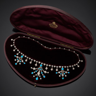 Edwardian gold mounted and platinum fronted turquoise and diamond necklace with provision to convert to a tiara. The floral features showing Art Nouveau influence. With original fitted case signed: A.J.T.Thorning. 9 Upper John St. Golden Square. London.W. £12,500.00
