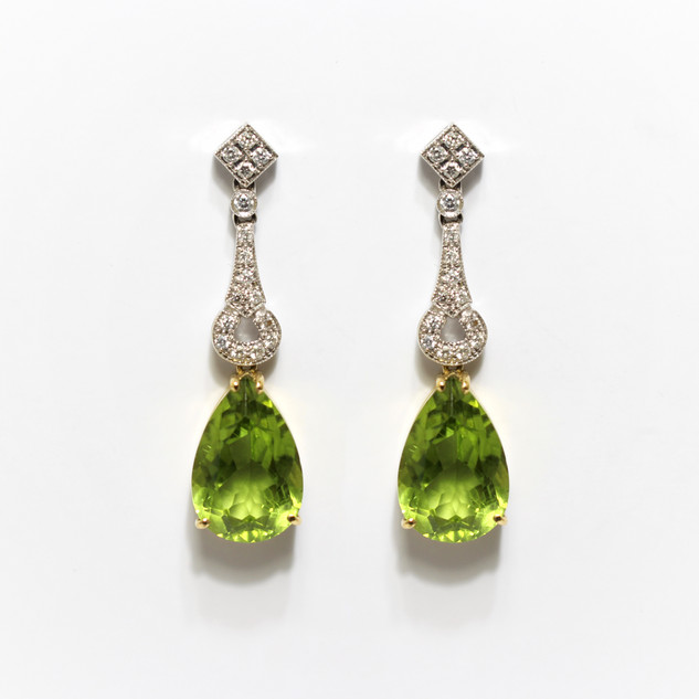 18ct yellow and white gold peridot and diamond drop earrings. Part of a pendant and earring set. The peridots in the earrings 8cts each, the peridot in the pendant 11cts. The complete cased set £5,250.00