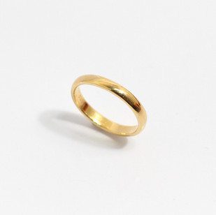 A 2.5mm 22ct yellow gold heavy weight 'Court' profile wedding band. Grey-Harris & Co hallmark. Most wedding rings are priced by weight. This example is a size L. £550.00 Please enquire for alternative price and sizing.