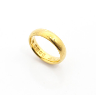 22ct yellow gold, 5mm court profile wedding ring. Hallmarked Sheffield, 1904. Engraving on the inside of ring with date 1911. £650.00