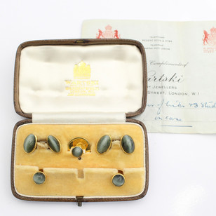 Cased dress set by Wartski. 18ct yellow gold and quartz cufflinks and dress studs. With original case and papers. £1,250.00