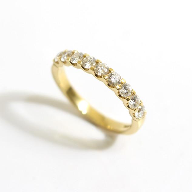 18ct yellow gold diamond half eternity ring. The brilliant cut diamonds totalling 0.87ct, G colour, Vs clarity. £2,200.00