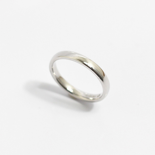 A platinum 'Court' profile medium weight wedding ring. Most wedding rings are priced by weight. This example is 3mm width and is a size N. £650.00