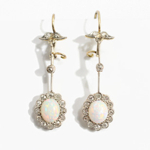 18ct yellow gold and platinum opal and diamond drop earrings, platinum set diamonds surrounding white opals with brilliant play of red and green. Circa 1920's £2,500.00
