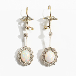 18ct yellow gold and platinum opal and diamond drop earrings, platinum set diamonds surrounding white opals with brilliant play of red and green. Circa 1920's £1,8500.00
