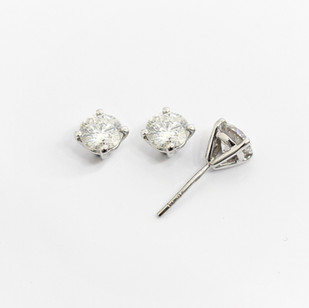 18ct white gold diamond stud earrings. The brilliant cut diamonds 1.01cts, H/I colour, Si2 clarity. Total diamond weight 2.02cts. £8,750.00