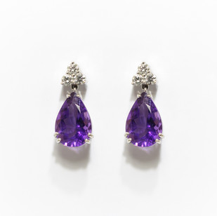 18ct white gold amethyst and diamond drop earrings. The drop shaped amethysts 5.39cts with trifoil of diamonds above, 0.39ct. £2,620.00
