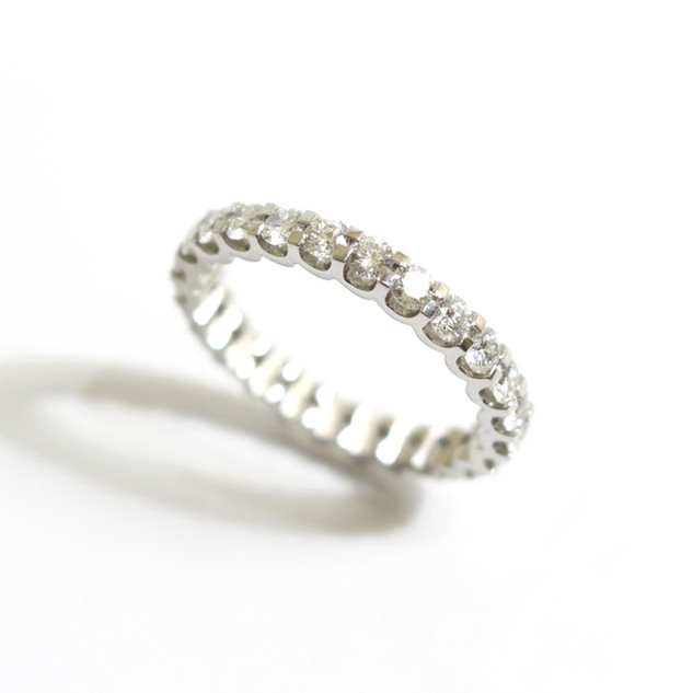 Platinum and diamond full eternity ring. Diamonds 1.46 ct, G colour, Vs clarity. Cog setting.  £3,950.00