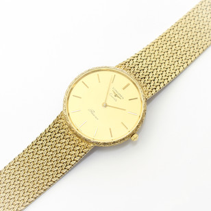 A 1960's 9ct gold Longines quartz wristwatch witha woven link bracelet. £2,650.00
