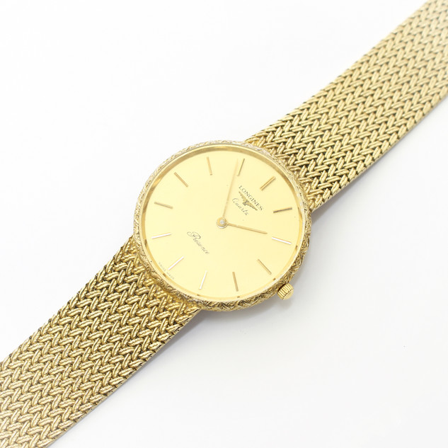 A 1960's 9ct gold Longines quartz wristwatch witha woven link bracelet. £2,650.00