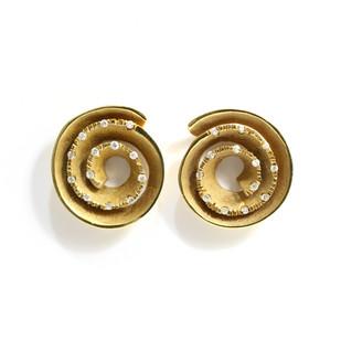 18ct yellow gold diamond set scroll design earrings of polished and matt finish. C1970. £2,450.00