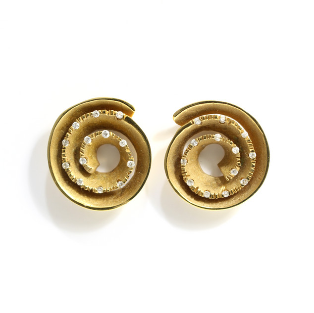 18ct yellow gold diamond set scroll design earrings of polished and matt finish. C1970. £2,450.00