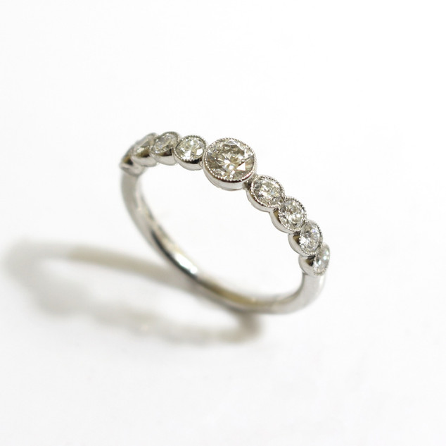 A platinum and diamond ring. The central brilliant cut diamond 0.30ct, G colour, Vs1 clarity. With brilliant cut diamond shoulders in a fine millegrain setting. £3,500.00