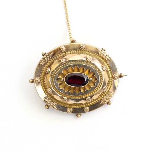 15ct yellow gold Victorain domed brooch set with a central oval garnet. Circa 1880. £225.00