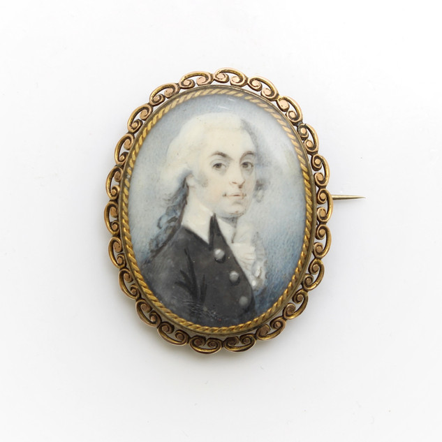 A gold mounted mother of pearl gentleman miniature. £450.00
