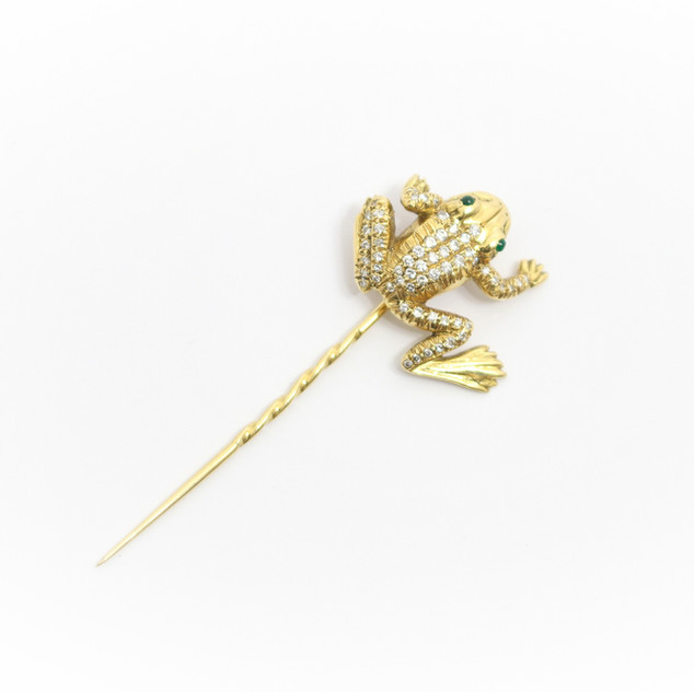 18ct yellow gold frog pin. The handmade frog is set with brillaint cut diamonds and cabochon emerald eyes. £1,250.00