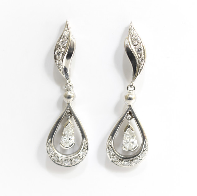 18ct white gold diamond drop earrings with pear diamond features. Total diamond weight 0.82ct. £3,250.00