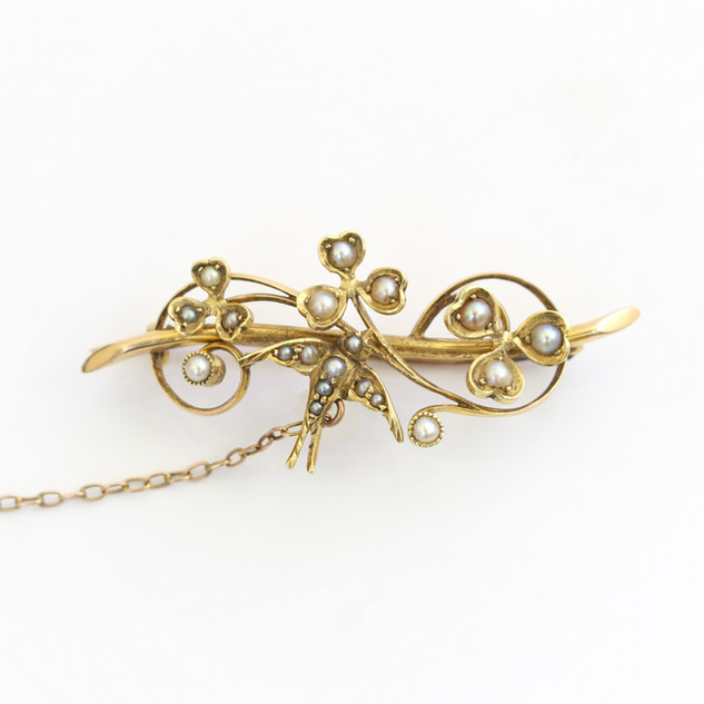 15ct yellow gold half pearl brooch with swallow and leaf form. Circa 1910. £125.00
