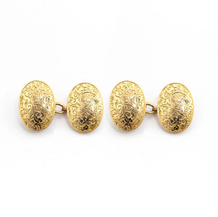 15ct yellow gold, domed oval cufflinks with floral engraving. £700.00