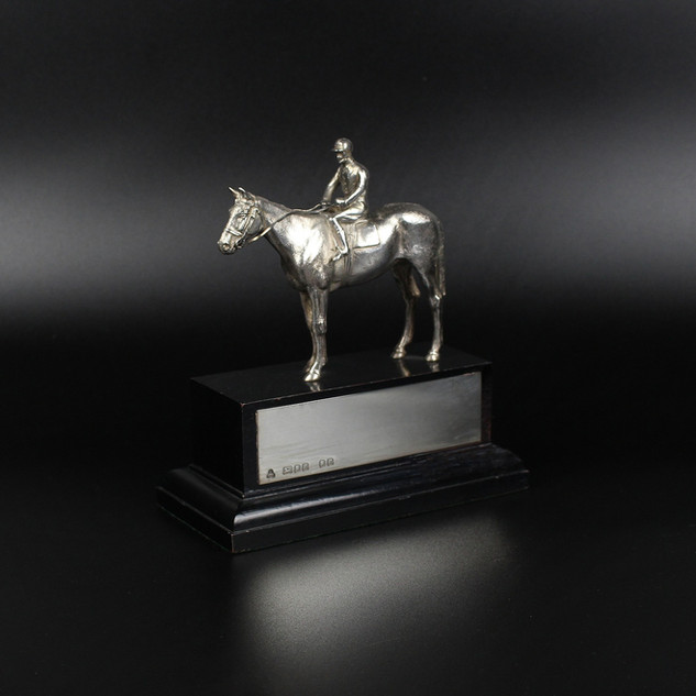 Wakely & Wheeler 199. Race horse and jockey. 4 inches On plinth with engraving plate   £ 1,200.00