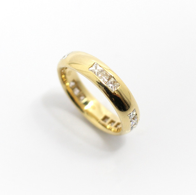 18ct all yellow gold diamond set wedding / eternity ring. The substantial court profile ring set with groups of 3 French cut diamonds in rubbed in settings. The total diamond weight 1.06ct, G colour, Vs clarity. £2,850.00
