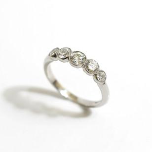 A platinum five stone diamond ring. The graduated brilliant cut diamonds totalling 1.30cts, G colour, Vs1 clarity. In a fine millegrain setting. £4,650.00