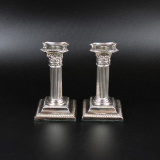 A pair of Corinthian column candlesticks. 1898. 5 inches  £ 385.00