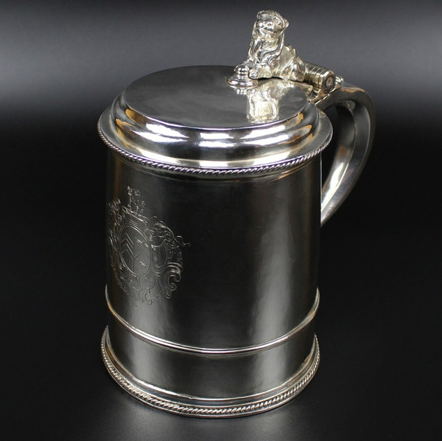 Style – Lidded with astragal moulding and rope boarders, lion couchant thumbpiece.    Date – 1707 Weight – 39 oz 18 dwt. Scratch weight 39 = 18 Dimensions – Extreme height 8 ½ inches Diameter at base – 5 ¾ inches Maker – Edmund Pearce  - makers mark: PE   Biography- Tewksbury, Gloucestershire association. Son of a hatter.  Apprentice to Philip Rollos.   Arms - more or less contemporary with Monson crest The Monson Arms and crest are those of the Lincolnshire family of Monson who were created baronets in 1611 and raised to peerage in 1728.  Marriage 1727. £22,500.00
