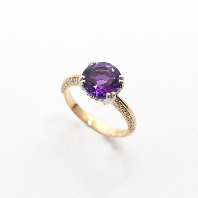 18ct yellow and white gold amethyst and diamond ring. The central circular amethyst 2.11cts with pave set diamond mount. £575.00