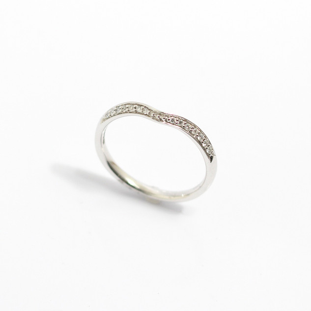 A platinum wishbone diamond set wedding band. 0.17ct. £485.00