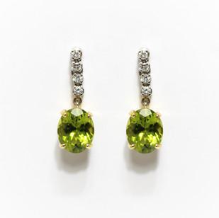 18ct yellow and white gold peridot and diamond drop earrings. £1,450.00