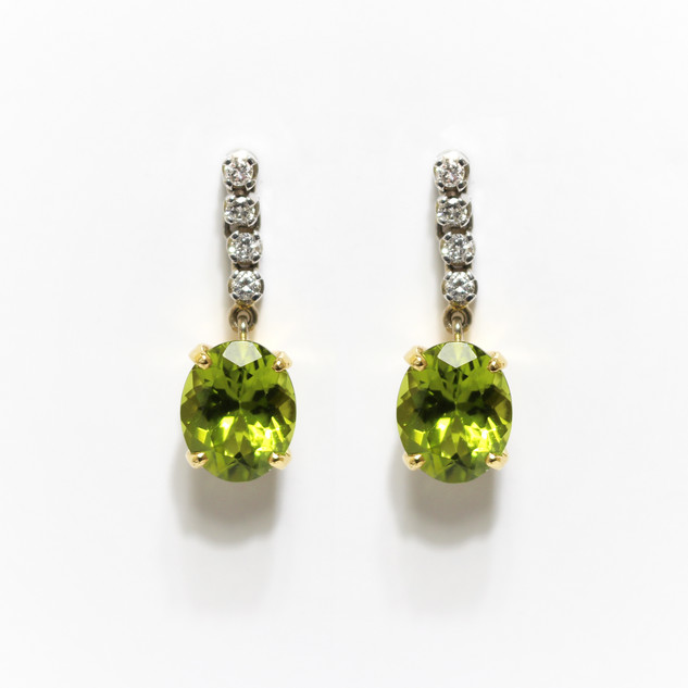 18ct yellow and white gold peridot and diamond drop earrings. £1,450.00