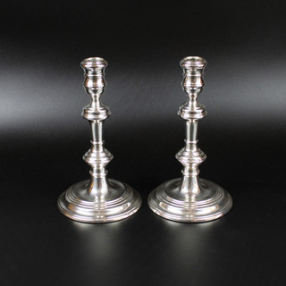 A Pair baluster style candlesticks. London 1970. 8 inches  £ 475.00