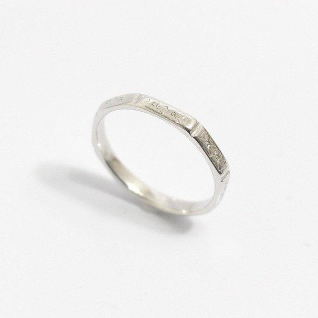 A platinum octagonal form wedding band with 'Court' profile interior and engraved detail to the eight sides. 2.5mm width and finger size N 1/2. £375.00