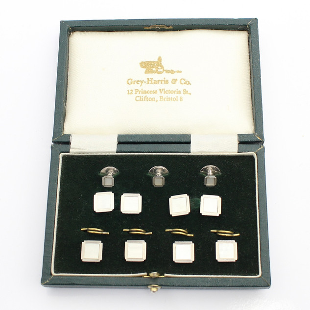 9ct white gold and mother of pearl dress set. The complete set comprising of cufflinks and studs. Cased. C1960. £775.00