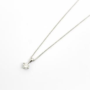 Platinum mounted solitaire diamond pendant. The single circular modern brilliant cut diamond 0.70ct, H colour, Si clarity. Claw setting.  £2,650.00