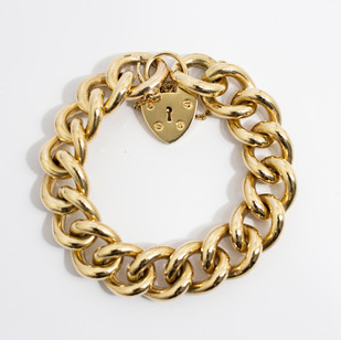 9ct yellow gold exceptionally heavy curb link bracelet with padlock clasp. 108 grams, hallmarked 1972. Fine condition. £3,750.00