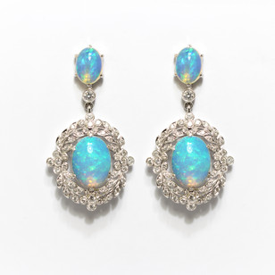 18ct white gold opal and diamond cluster drop earrings. The opals totalling 5.56cts with diamond set filigree sourrounds totalling 0.79cts. £4,250.00