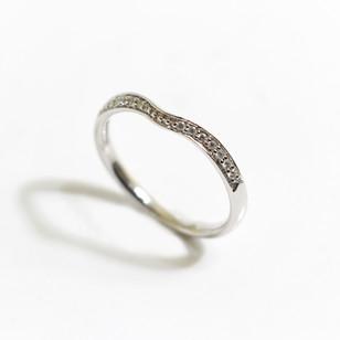 A platinum diamond set wish bone shaped band, 0.17ct. £485.00