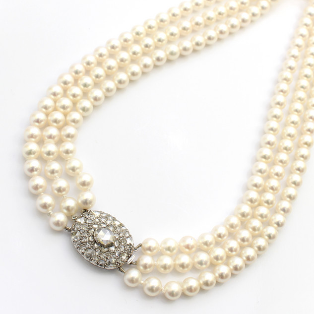 A three row clutured pearl necklace, 6mm in diameter. Completed with a white gold rose cut diamond clasp. £4,500.00